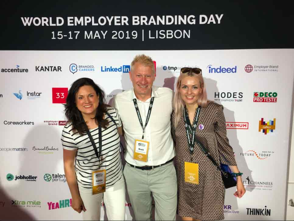 Hostinger's people team members Gabija Jasiulionyte and Brigita Pruskaite together with Brett Minchington - one of the world's leading authorities on employer branding